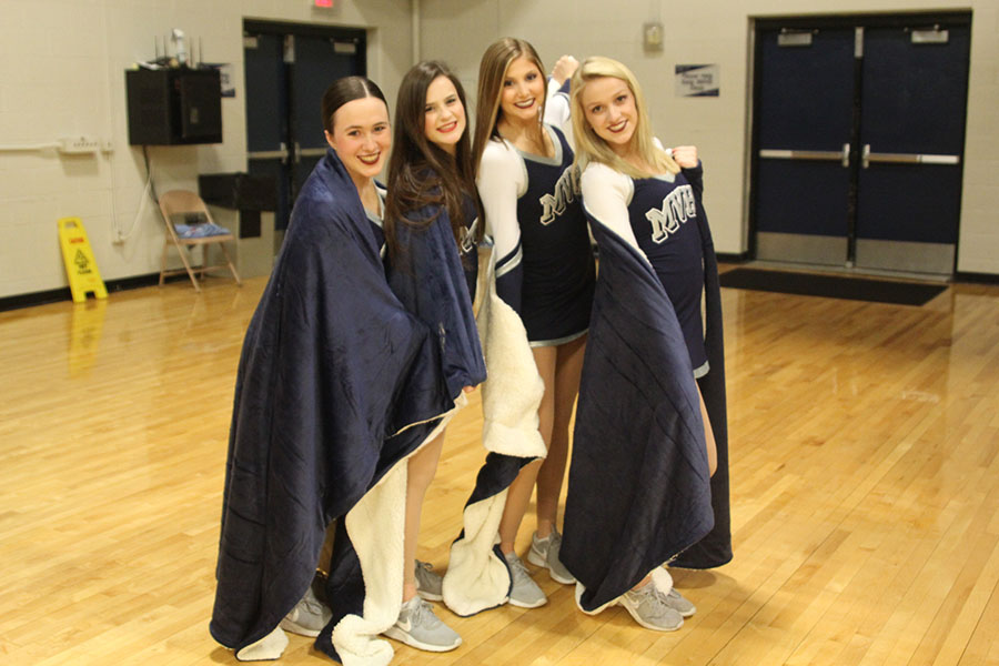 The four senior members of the Silver Stars dance team received customized blankets prior to the girls basketball game on Thursday, Feb. 28 to thank them for their leadership on the team.