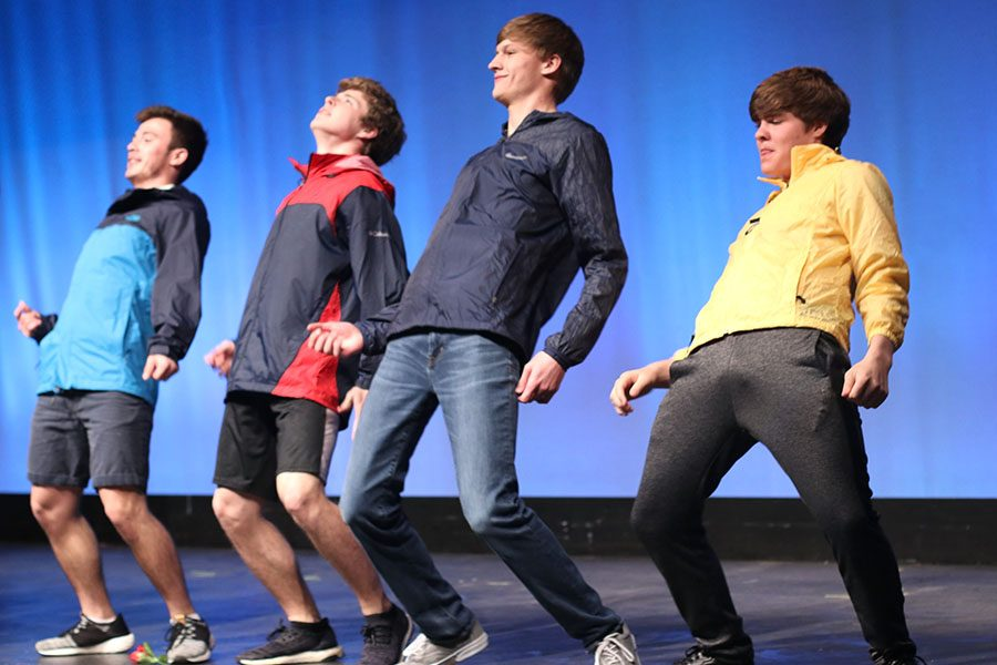 """With """"It's Raining Men"""" by The Weather Girls playing, the Mr. Mill Valley contestants perform their choreographed dance routine."""