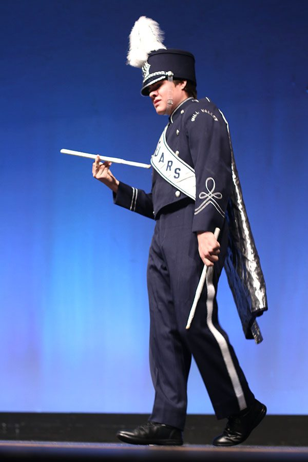 """Twirling his drumstick and holding a smirk, senior Zach Bossert is introduced to the audience as """"Mr. Percussion""""."""