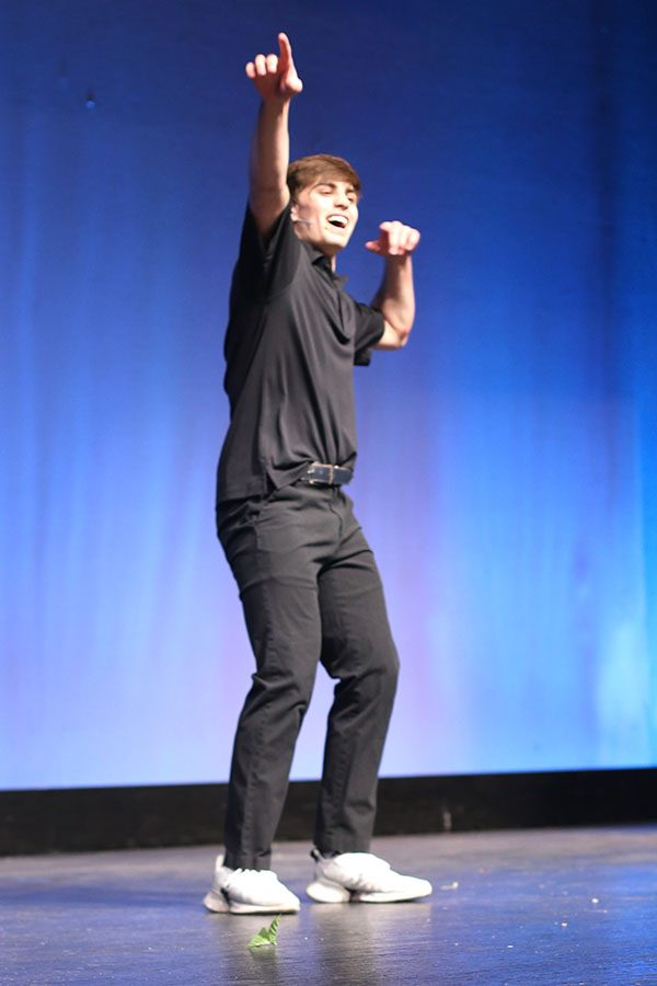 """Performing his rendition of """"Breaking Free"""" from High School Musical, junior Cline Boone points to the sky."""