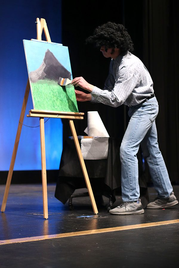Competing in the talent portion of the show, junior Ben Stove gives a Bob Ross-inspired painting tutorial.