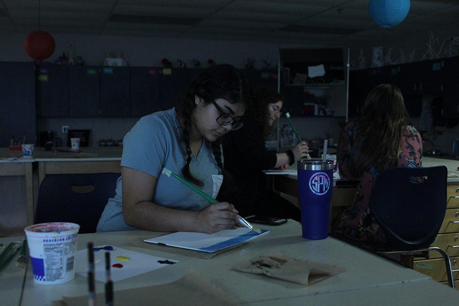 Working on her horizon, senior Fatima Hernandez works on a winter painting.