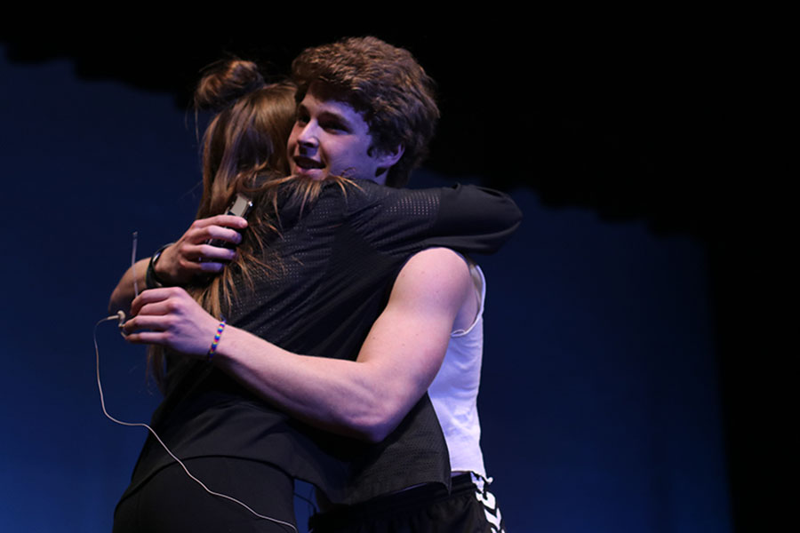 While reciting his poem, senior Steven Colling asks Lydia McDaneld to go to prom with him at the annual Mr. Mill Valley event held on Wednesday, March 20.