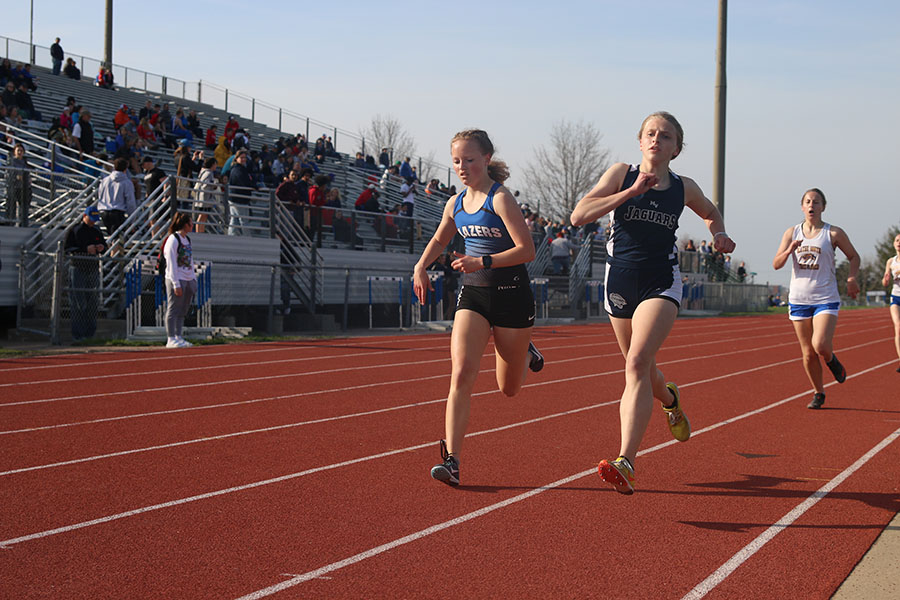 Head-to-head+with+her+opponent%2C+freshman+Bridget+Roy+competes+in+the+1600+meter+run.