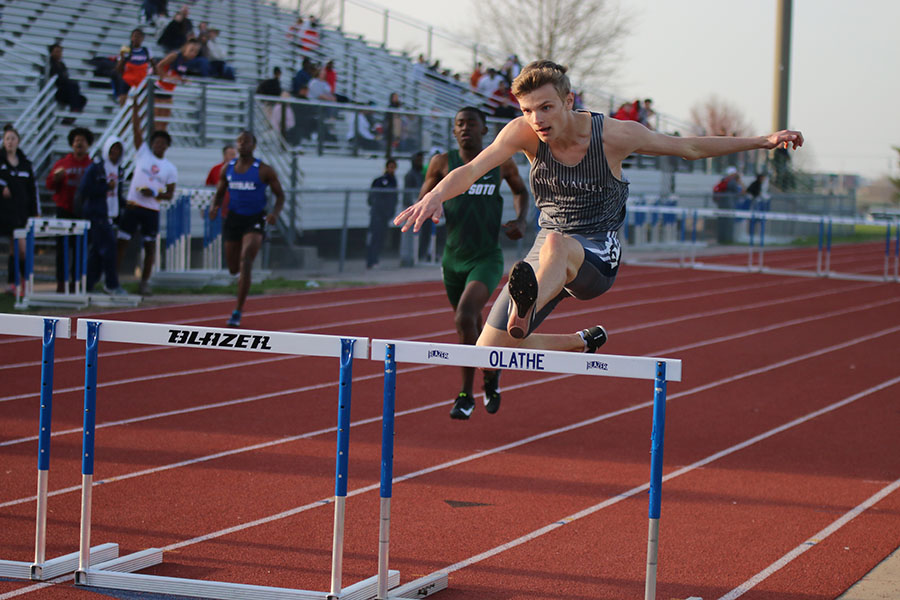 Jumping+over+the+hurdle%2C+sophomore+Leif+Campbell+competes+in+the+110+meter+hurdles.