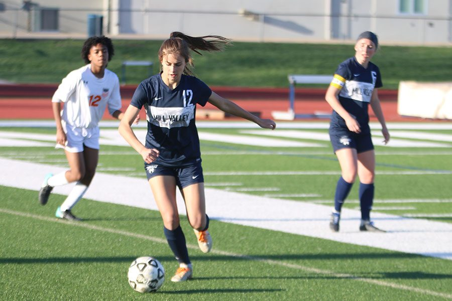 After getting the ball back, sophomore Avery Rutkowski dribbles the ball back upfield.