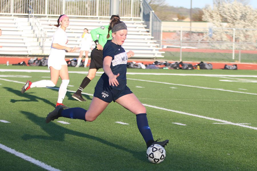 With her eyes on the ball, sophomore Paige Goetsch gets ready to pass the ball.