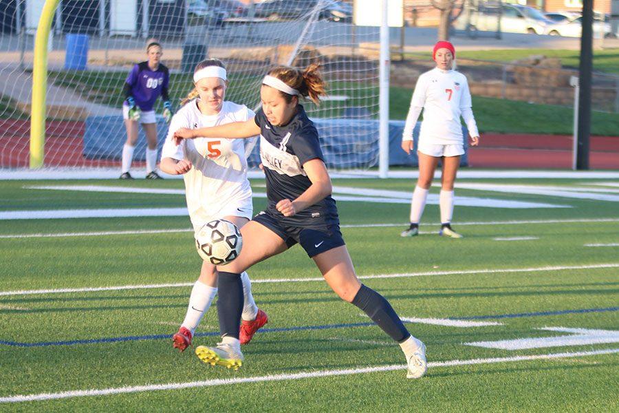 Pushing past the defender, junior Tina Talavera makes her way to the goal.