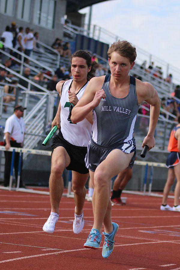 Eyes focused ahead, senior Jakob Twigg races during the 4x800 meter relay.
