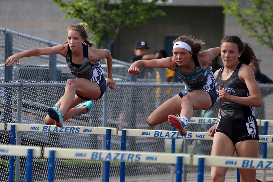 Competing during the 110 meter hurdles, freshmen Emree Zars and Reece Johnston race alongside each other. Johnston finished the event in seventh with Zars finishing in eighth.