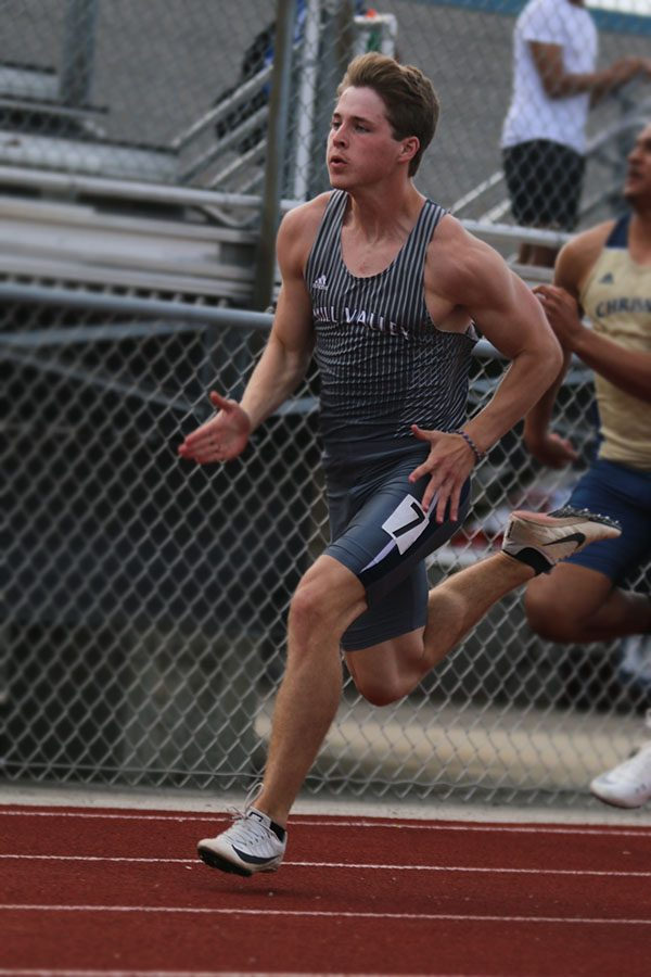 Competing in the 100 meter dash, senior Steven Colling races towards the finish line. Colling finished the event in 10th place.