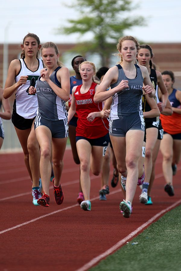 Leading the race, sophomore Molly Ricker and freshman Katie Schwartzkopf run alongside each other during the 1600 meter run. Ricker finished the race in second, with Schwartzkopf finishing in fourth.