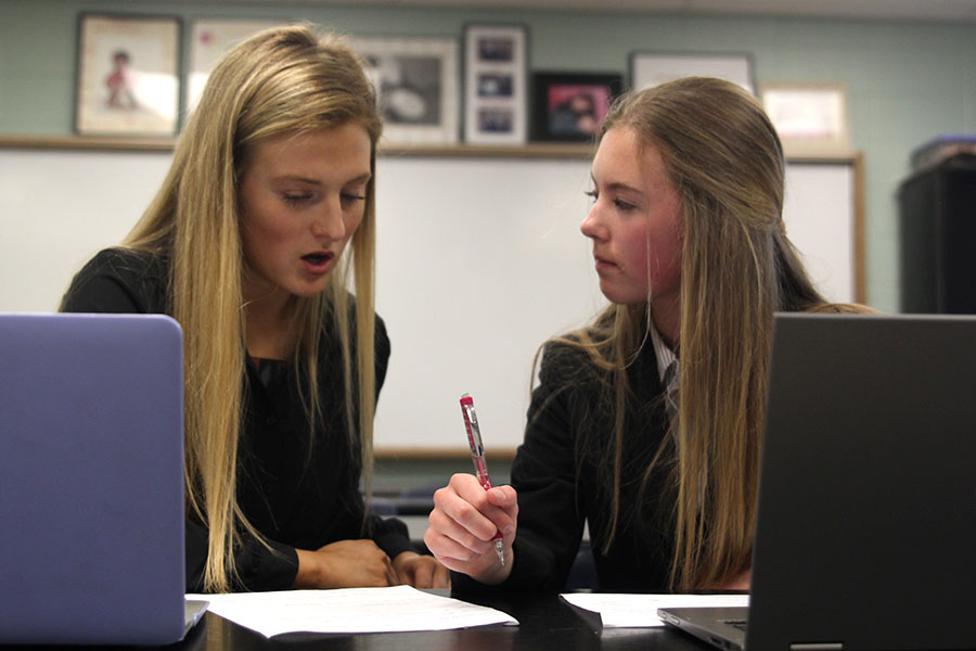 During+prep+time%2C+junior+Annie+Bogart+and+sophomore+Anna+Owsley+discuss+what+arguments+they+should+bring+up.