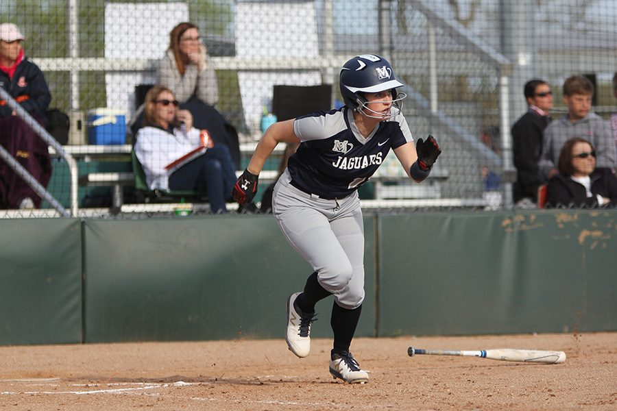 After a hitting a single to the outfield, junior Paige Oliver runs for first base.