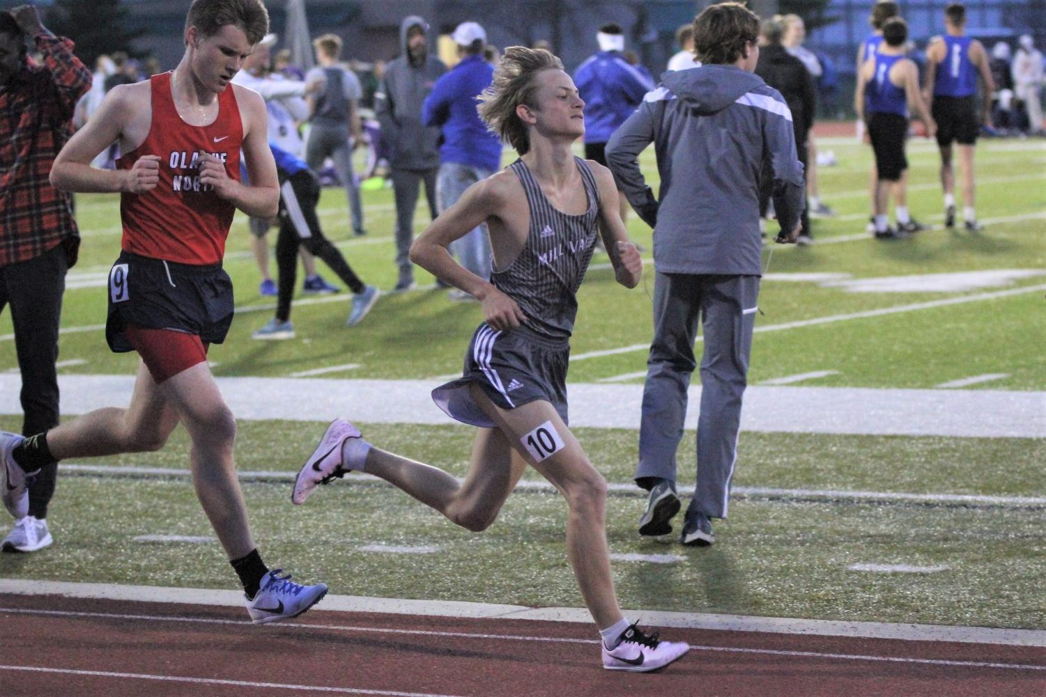 Running+ahead+of+his+competitor%2C+sophomore+Cameron+Coad+competes+in+the+3200+meter+race.