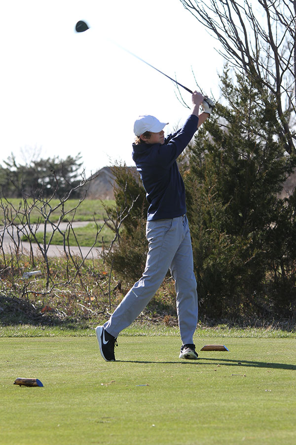 Teeing+off+at+hole+11%2C+senior++Tanner+Moore+follows+through+with+his+swing+and+finishes+16th+overall.