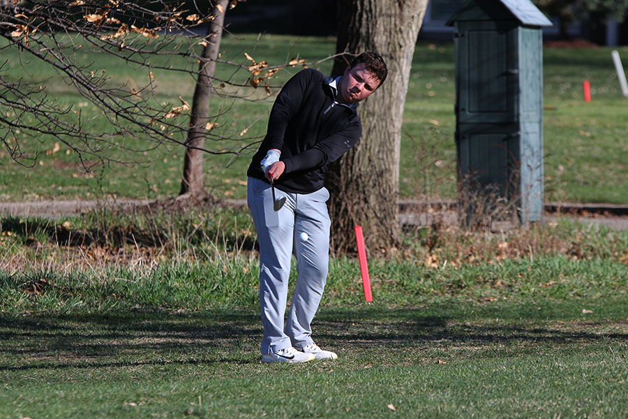 Controlling his swing, junior Charlie Flick lands his ball on the green while getting it out of the rough during hole 15 to place 30 at the BVNW Invitational.