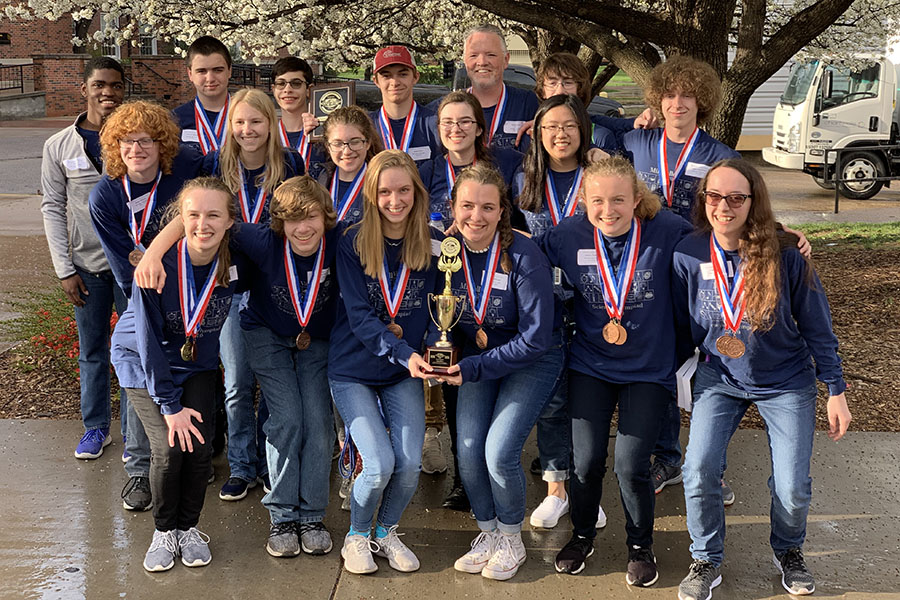 "After the award ceremony, the team poses for a picture after their third place victory. The team ended with a total score of 136 points, 22 points behind the second place team. ""Our team has become like a family over the season,"