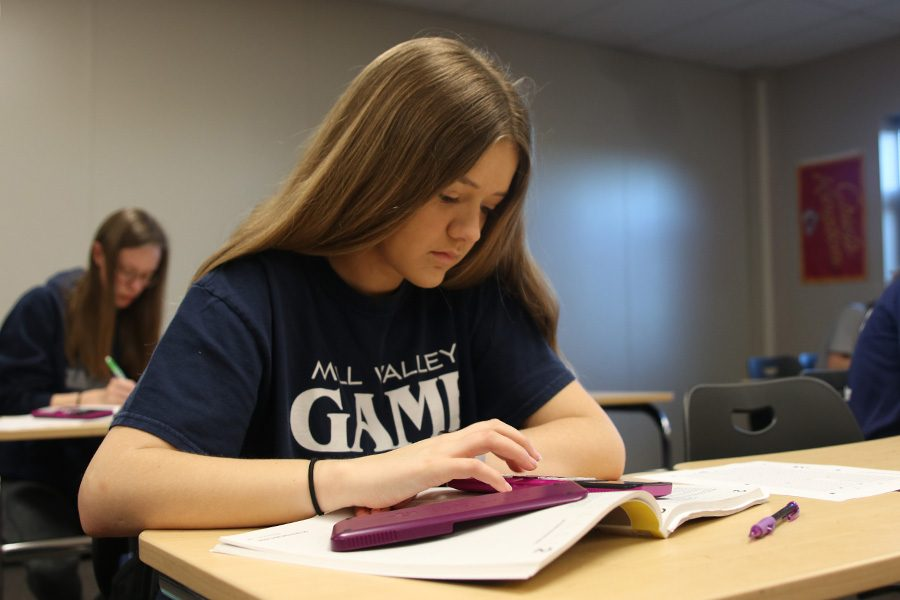 During ACT prep class on Monday, April 8, junior Taegan Evans practices the math portion.