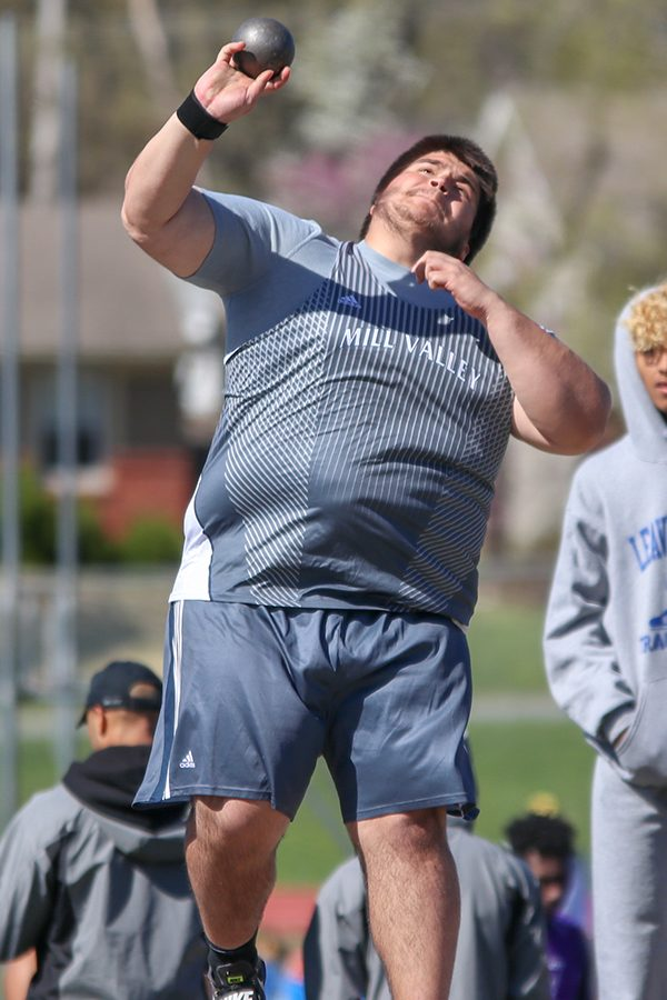 Looking towards the sky, junior Justin Sanders throws the shot put.