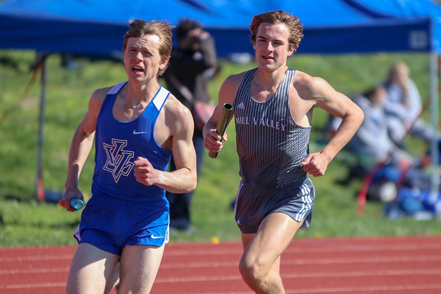 Following a Leavenworth runner, junior Nick Schmidt competes in the first leg of the 4-by-800-meter relay.