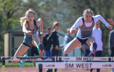 Looking down towards the next hurdle, freshman Reese Johnston and senior Erin Miller compete in the 100-meter hurdles.
