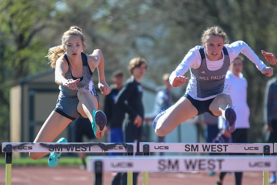 +Looking+down+towards+the+next+hurdle%2C+freshman+Reese+Johnston+and+senior+Erin+Miller+compete+in+the+100-meter+hurdles.+