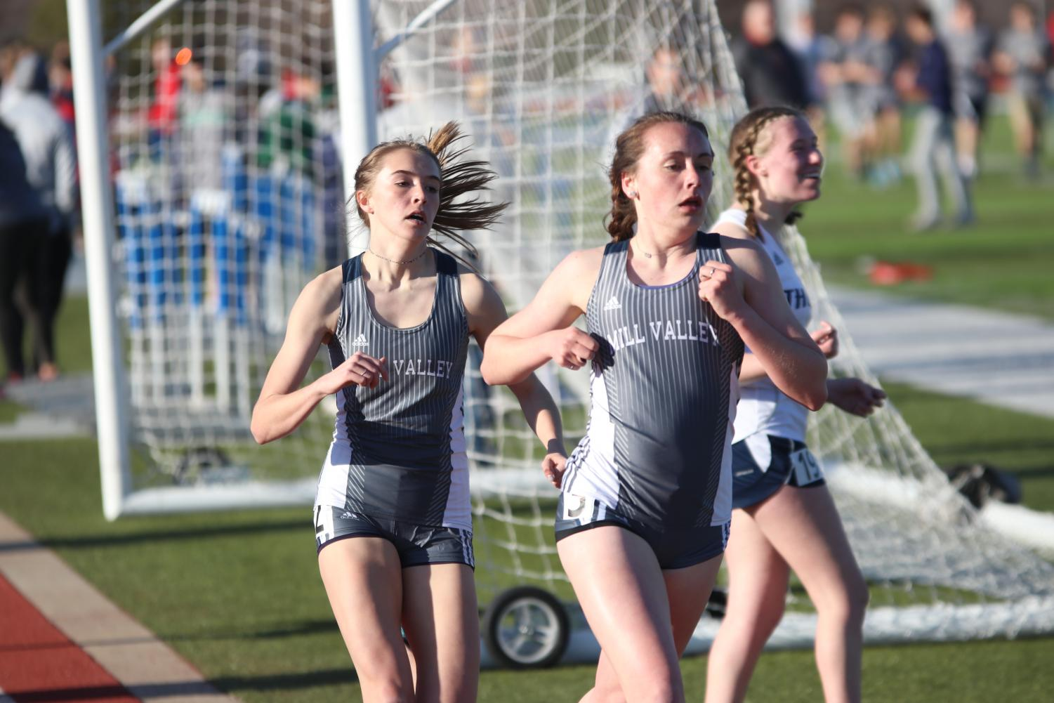 During the 800 meter dash on Friday, April 5, senior Delaney Kemp competes with her teammate junior Molly Haymaker. Kemp, like other girls varsity athletes at Mill Valley, was forced to choose between soccer and running during her freshman year.