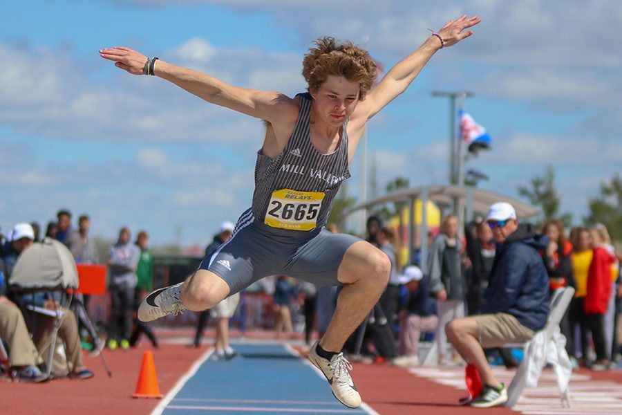Spreading his arms apart, senior Steven Colling competes in the triple jump competition at KU Relays on Friday, April, 19. Colling finished 18th.