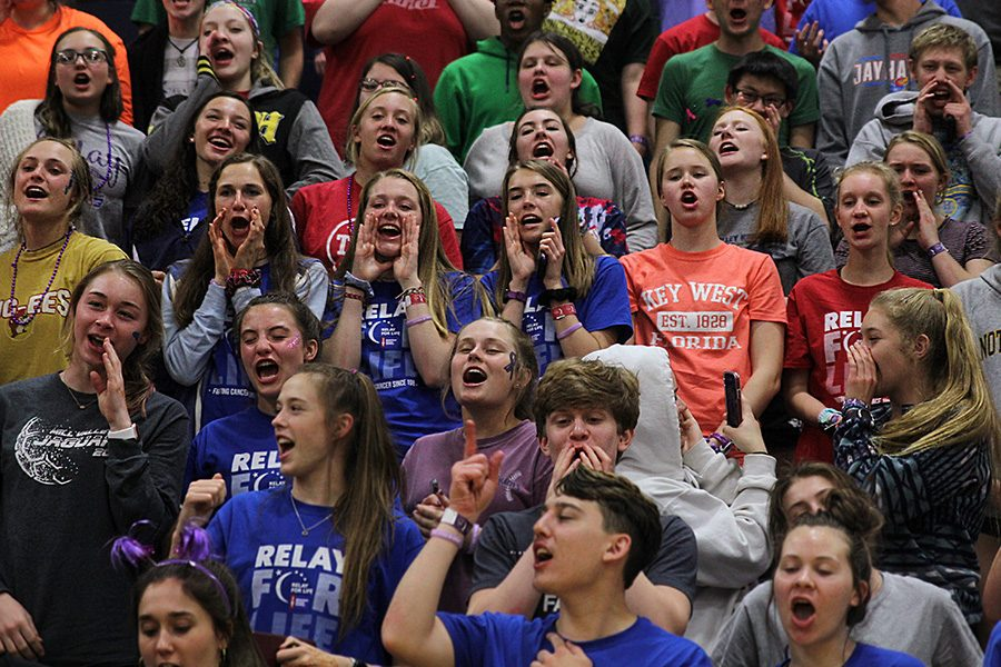 With+their+hands+around+their+mouths%2C+the+student+section+ends+the+Relay+for+Life+pep+assembly+by+chanting+%E2%80%9CLet%27s+go+Jags%E2%80%9D+Friday%2C+March+29.+The+%E2%80%9CHey+Hey+Whaddya+Say%E2%80%9D+chant+has+been+a+longstanding+tradition+with+the+student+body.+Senior+Johannes+Seberger+believes+it+is+what+makes+the+student+section+at+the+school+unique.+%E2%80%9CThe+call+and+response+set+up+of+the+%E2%80%98Hey+Hey+Whaddya+Say%E2%80%99+chant+makes+people+have+to+participate.+It+is+a+way+for+everyone+to+be+a+part+of+the+school+and+its%E2%80%99+environment%2C%E2%80%9D+Seberger+said.+%E2%80%9CWhile+this+chant+is+short%2C+it+makes+people+get+involved+at+the+school+even+though+it+is+in+a+small+way.+It+shows+the+pride+you+have+for+your+school.%E2%80%9D