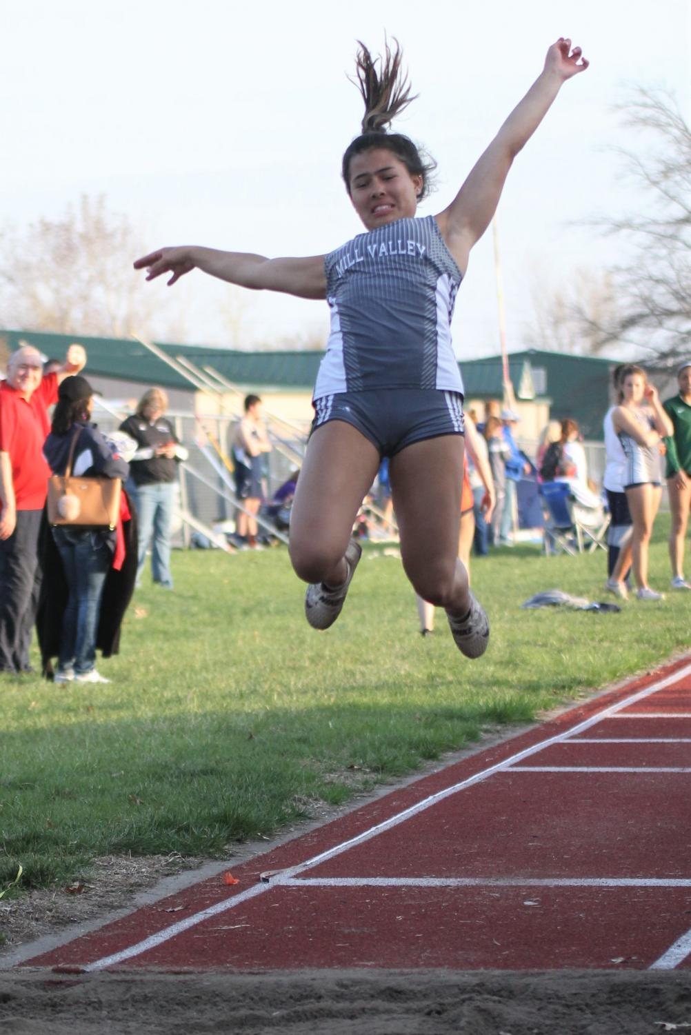Jumping+high%2C+senior+Mya+Johnston+competes+in+the+long+jump+event.