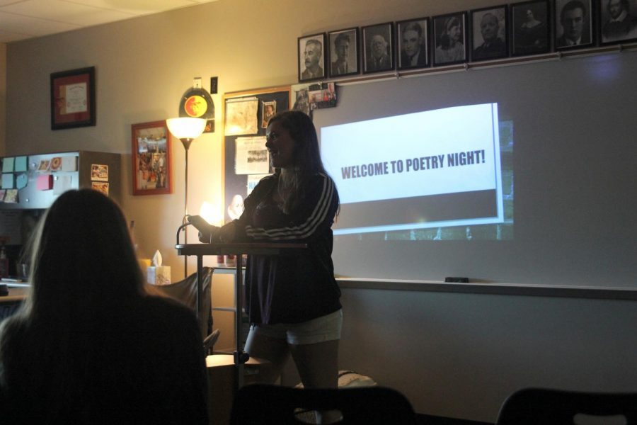 Standing+in+front+of+the+crowd%2C+senior+Deanna+Newman+reads+her+poem.+