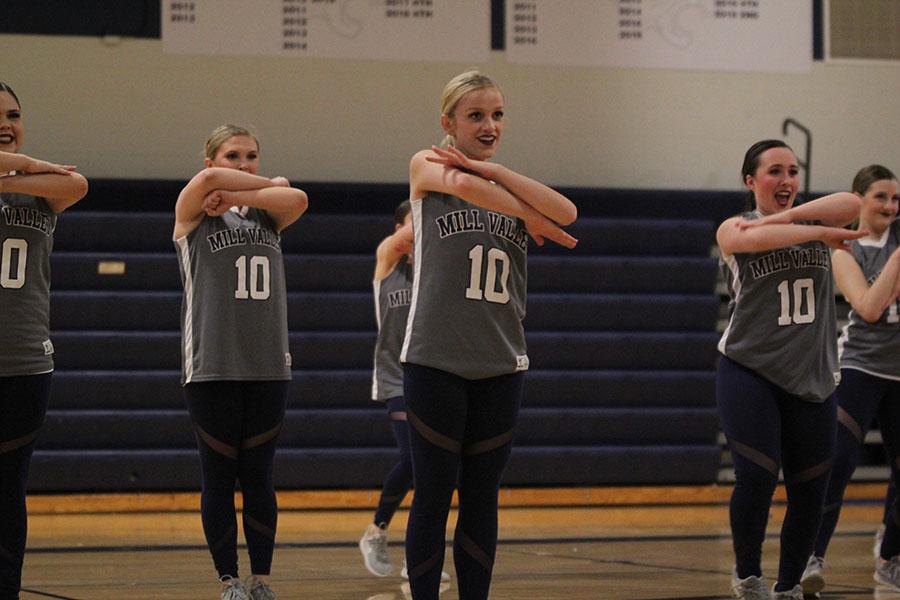 Leading+the+team%2C+senior+Bella+Line+performs+alongside+senior+Eve+Steinle+and+sophomore+Jenna+Haase.+