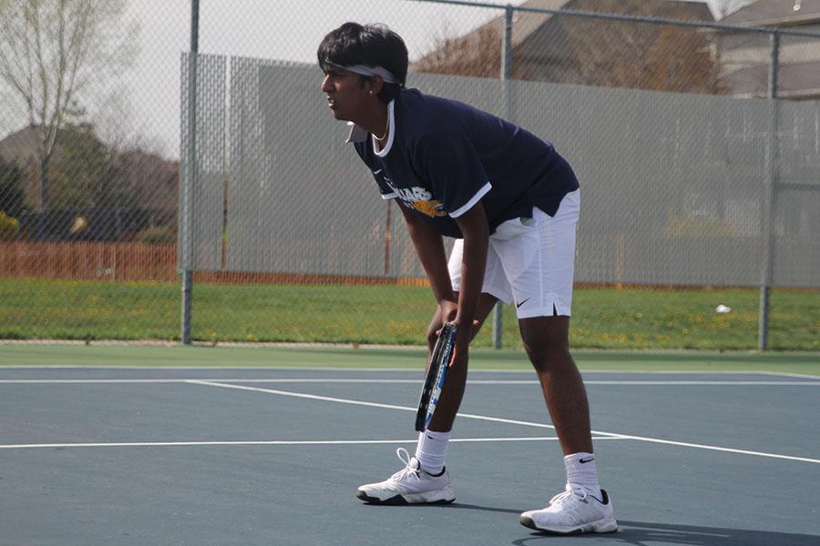 Preparing+to+serve+the+ball%2C+junior+Srikar+Turaga+holds+his+racket.