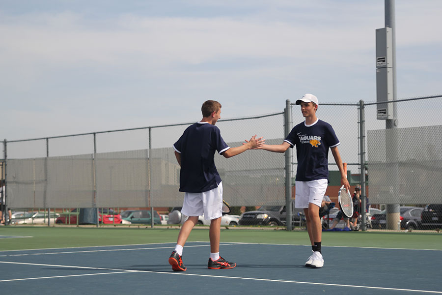 During+a+doubles+match%2C+sophomore+John+Scarpa+shakes+hands+with+his+partner.