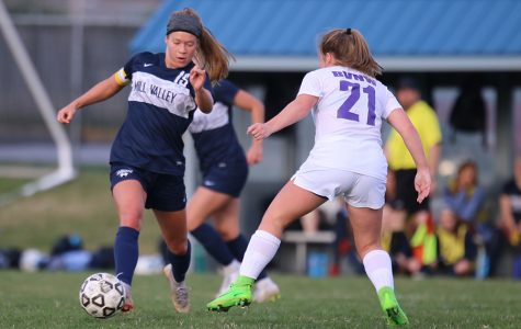 Dribbling the ball down the field, senior Shyanne Best keeps the ball out of reach from the defender.