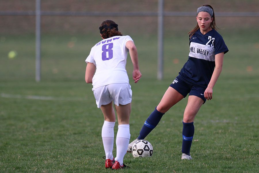 Trying to cross the ball, junior Katherine Weigel ignores a BVNW player.