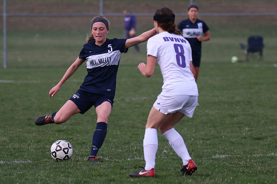 Running toward the ball, junior Annie Hoog rushes past a BVNW defender.