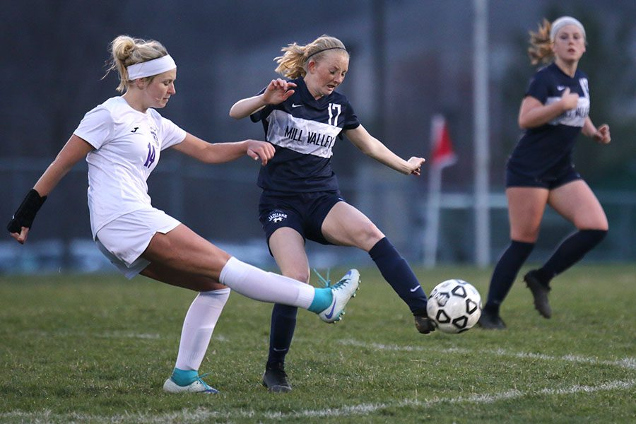 At the end of the first half, senior Kendra Bross tries to maintain possession of the ball.