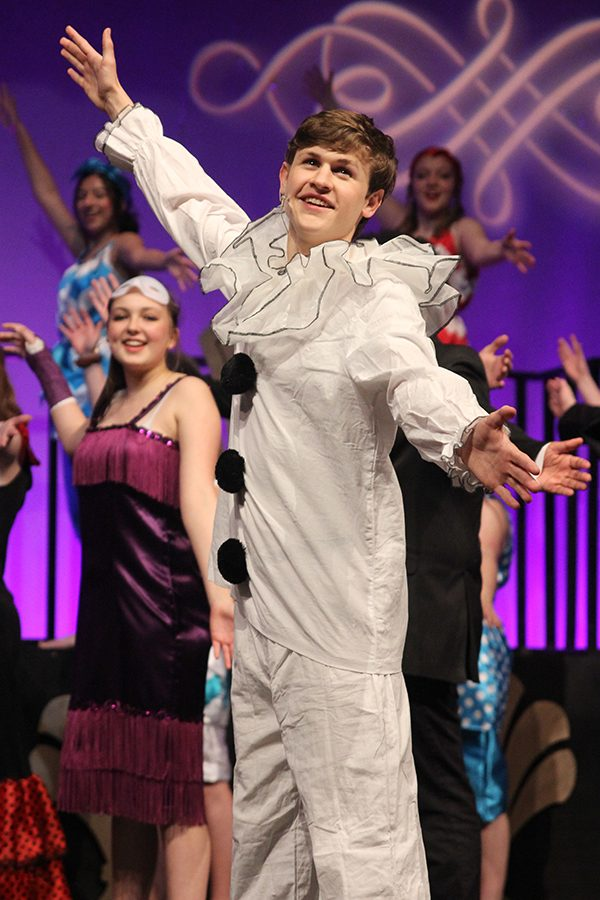 At the end of the show, senior Noah Smith poses during curtain call.