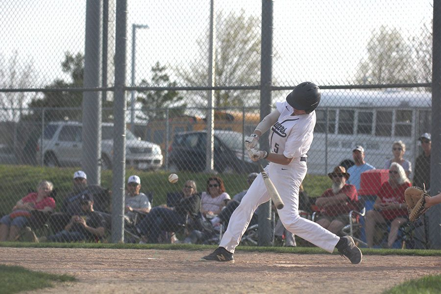 Swinging to hit the ball, sophomore Lucas Pringle hits the ball out to the right field on Tuesday, April 16.