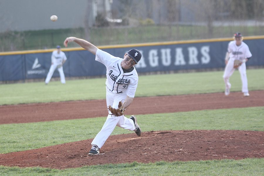Extending his arm, junior Brandon Rader throws the ball.