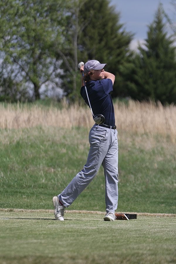Turning forward, senior Tanner Moore watches his ball travel down the freeway.
