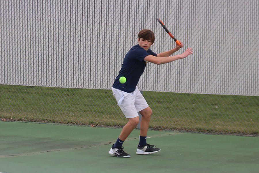Swinging+his+racket+back%2C+junior+Ben+Stove+keeps+his+eyes+on+the+ball.