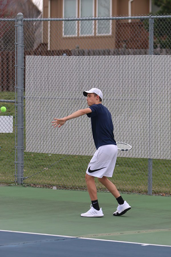 Taking a step towards the ball, junior Josh Glunt looks to make contact with the ball.