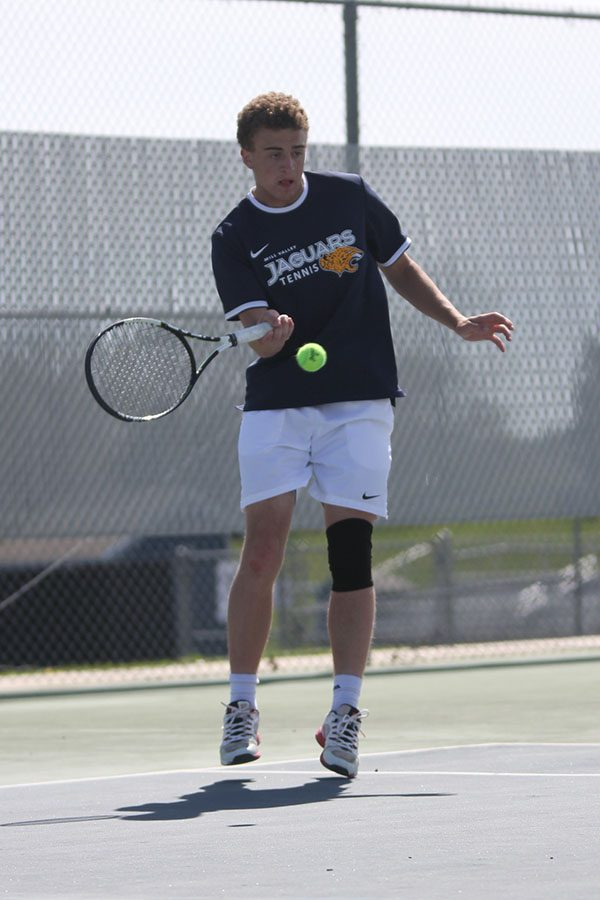 During+his+doubles+match+on+Monday+April+15%2C+junior+Aidan+Taylor+hits+the+ball+from+the+edge+of+the+court.