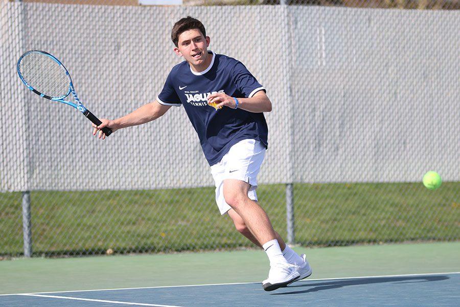 Keeping an eye on the ball, sophomore Keaton Verdict sprints along the baseline.