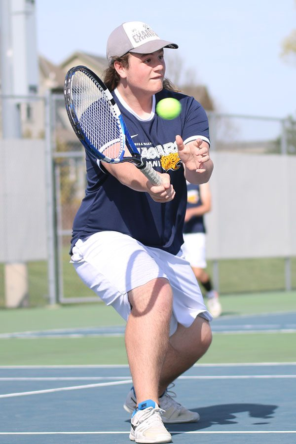 Hitting a volley, junior Charlie Schwartzkopf looks to pop the ball just over the net.