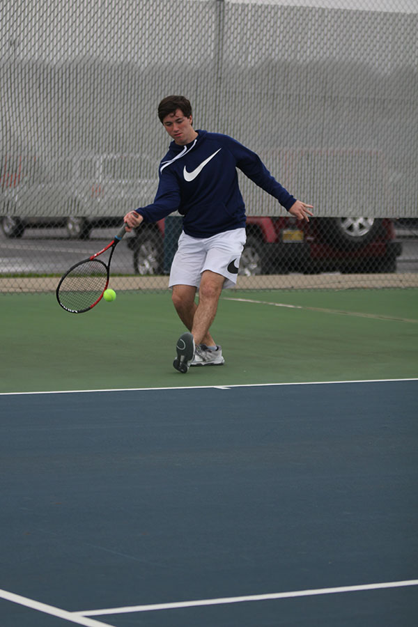 Following+through+with+his+racket%2C+junior+Joey+Gillette+underhands+the+pass.
