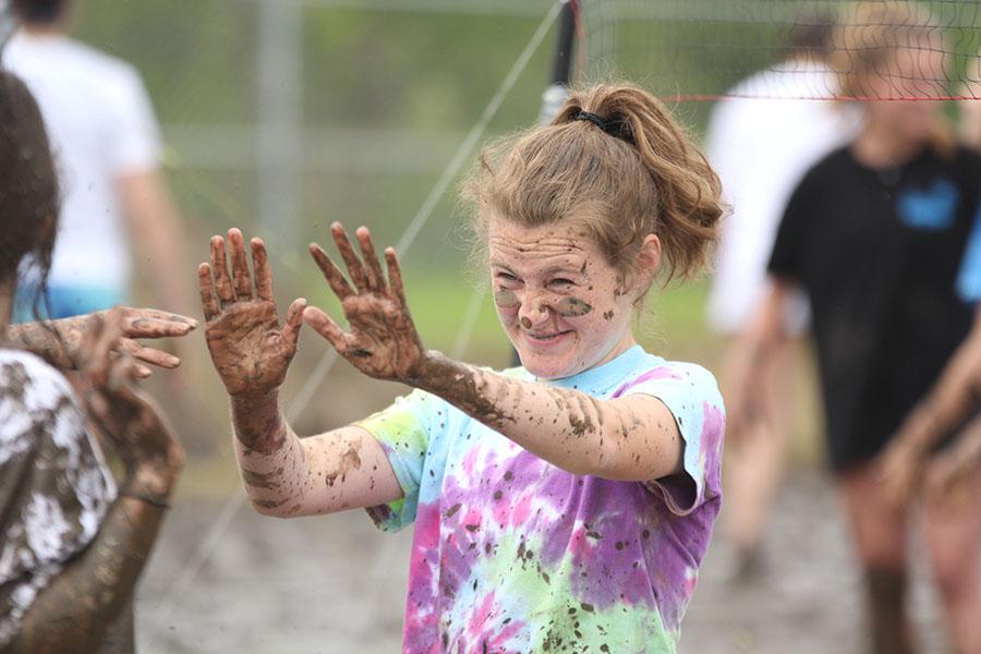 Throwing+her+hands+up%2C+freshman+Lauren+Walker+gives+high+fives+after+her+match.+